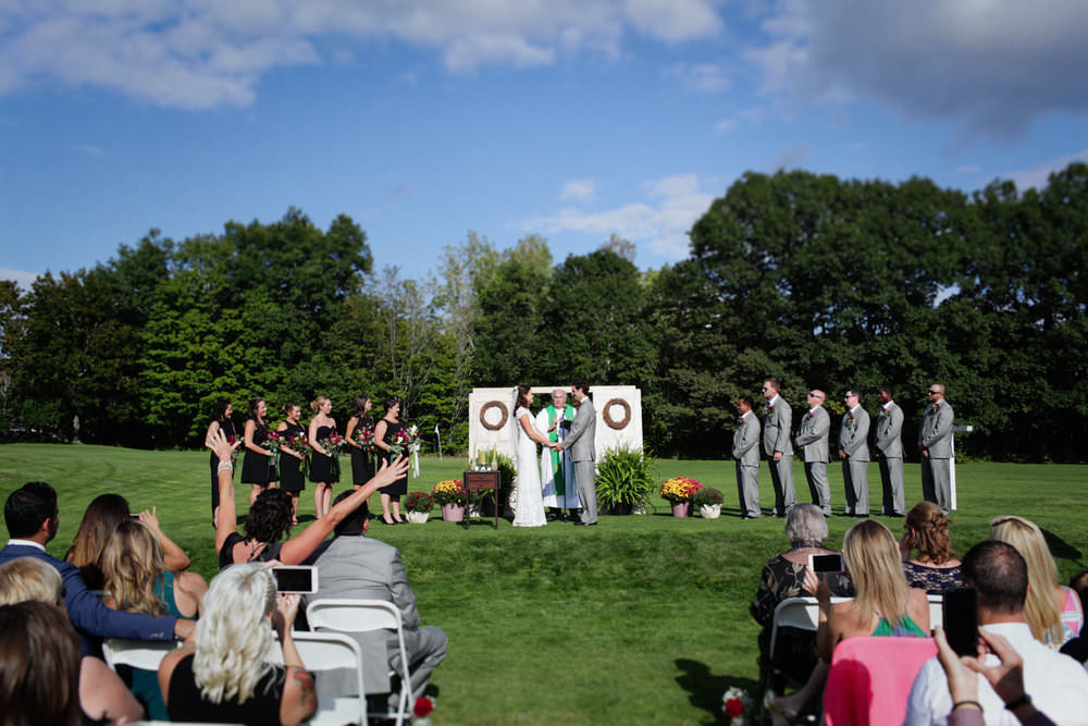outdoor ceremony on golf course fall crossing lunenberg central mass wedding photographer