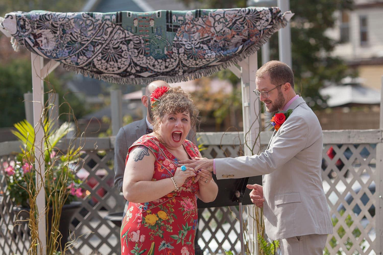 jamaica plain wedding at bella luna red dress patio ceremony