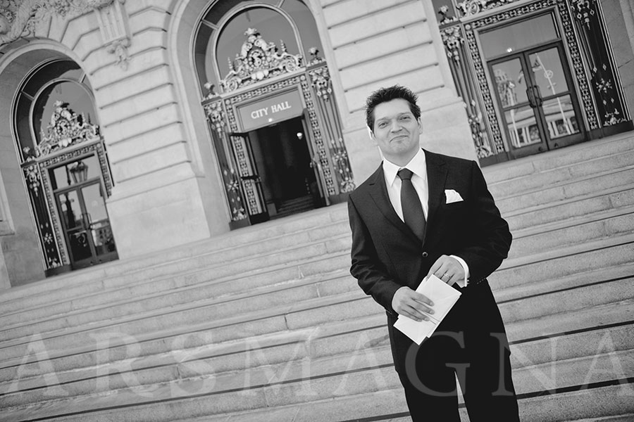 Groom waiting with the marriage license in hand at City Hall