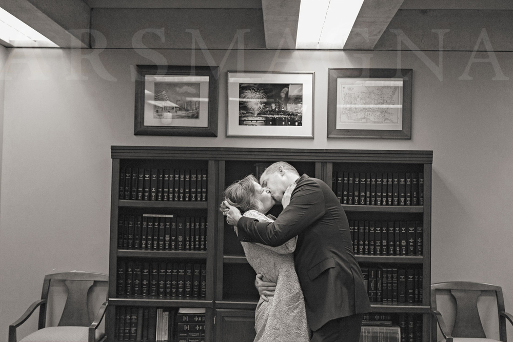 A passionate kiss sealing the deal at a Boston City Hall wedding.