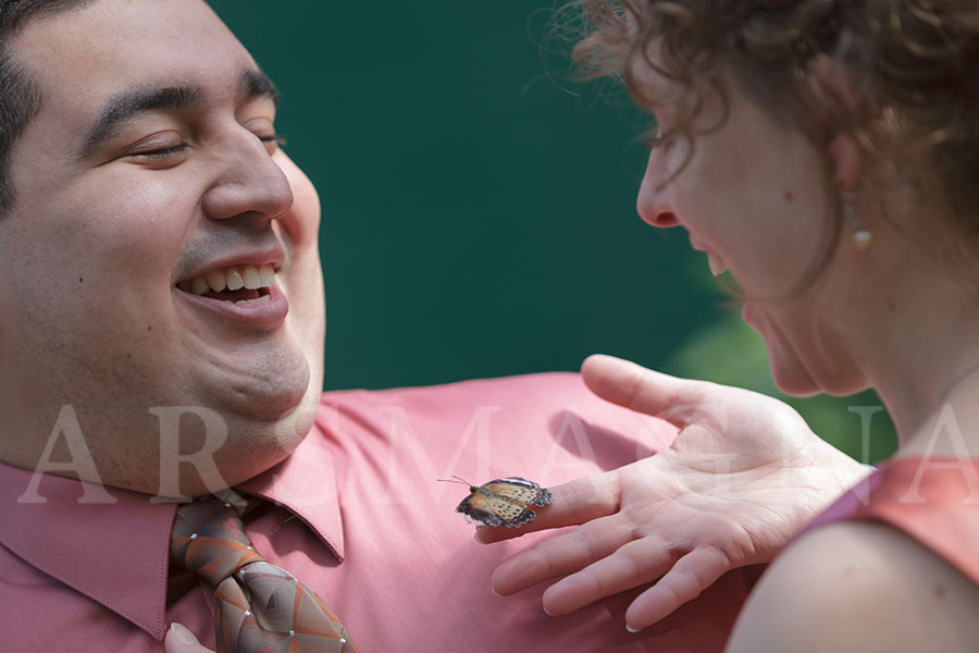 Elopement at the Butterfly Place, complete with butterfly and smiles.