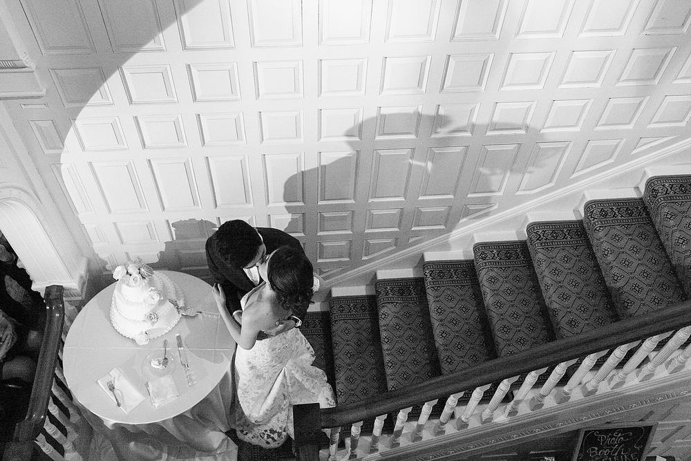 Lyman estate wedding cake cutting kiss