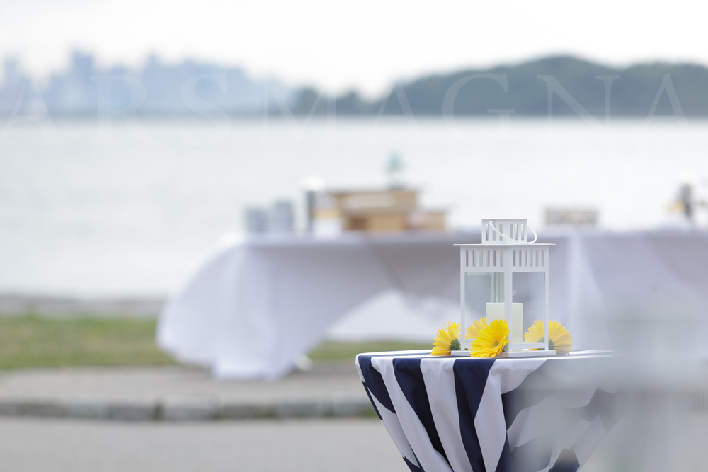 simple and nautical both, broad navy and white striped tablecloths with yellow gerbera daisies decked the belly tables on the patio