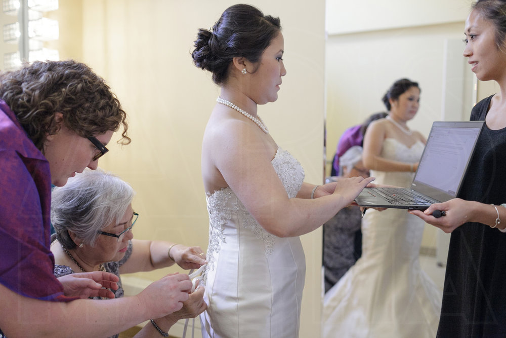 I love this 21st century Ladies in Waiting image, where the bride is finalizing her vows on her laptop at the Shalin Liu performance Center wedding in rockport