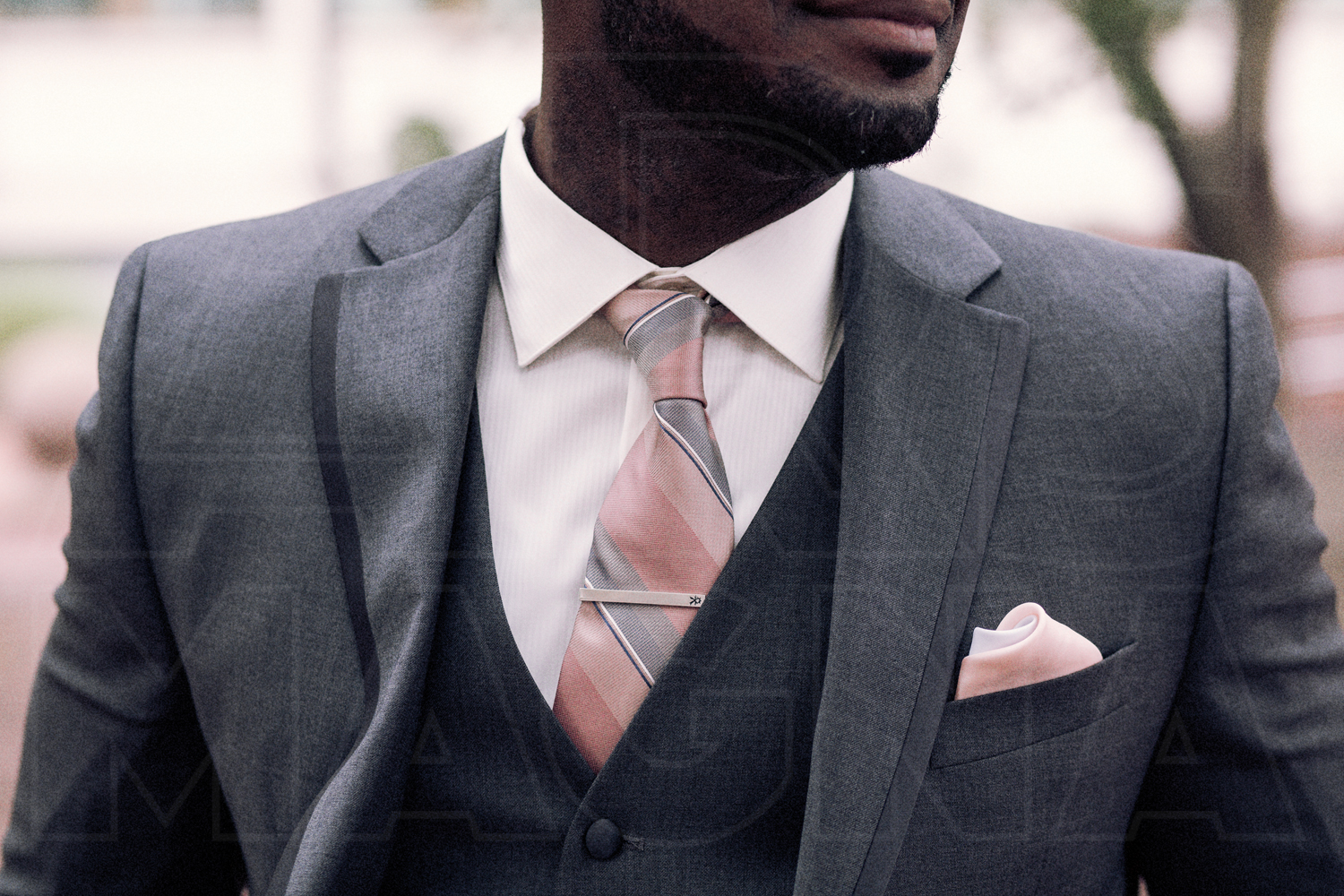 groom grey three piece suit pink tie pink pocket square