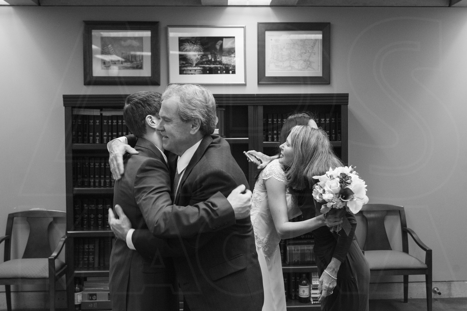 hugs from family at city hall wedding boston