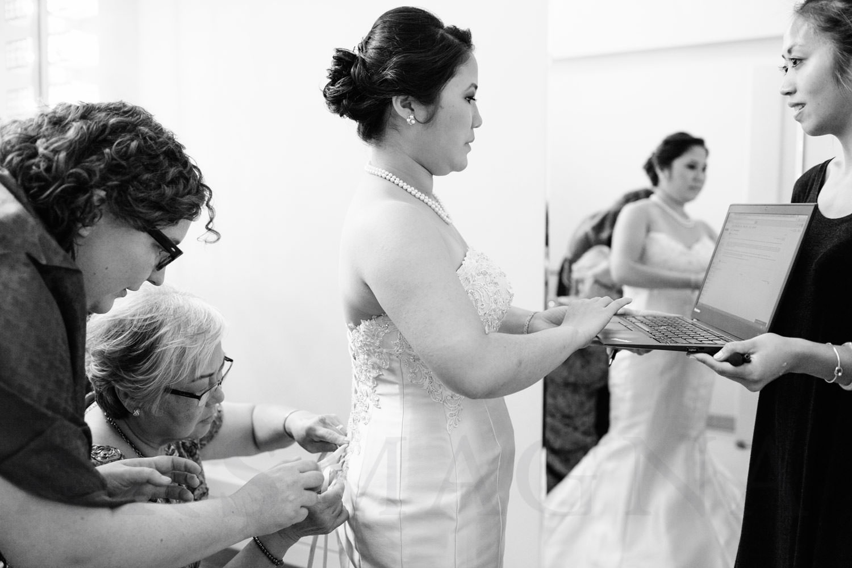 Shalin Liu Performance Center Wedding bride on laptop