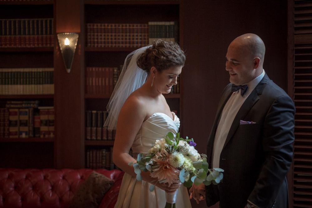 indoor first look hilton boston faneuil hall rainy wedding photographer