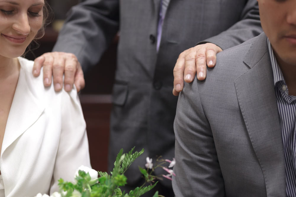 groom's father gives blessing boston wedding photographer