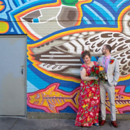 bella luna wedding photography jamaica plain red dress mural purple cactus center street