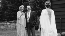 first look with parents bride groom diy rustic wedding boston backyard vintage