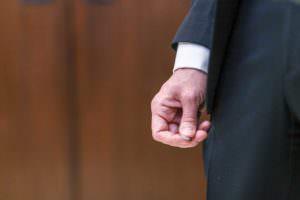 groom holding ring before ceremony boston city hall