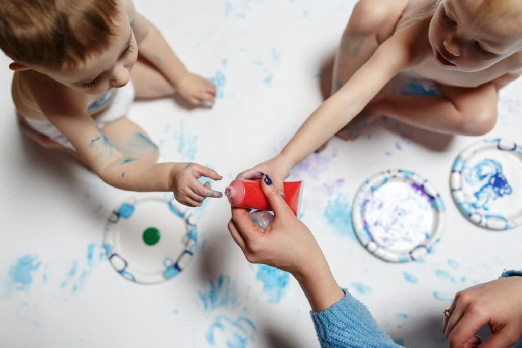 red finger painting toddlers having fun at home family portrait session